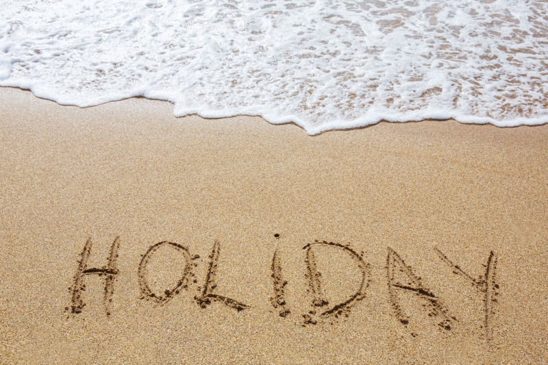 Holiday Written in the Sand © Bjørn Hovdal | Dreamstime.com